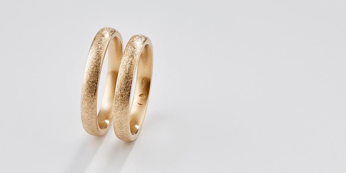 Trouwringen Curved, 18k brons rosé goud