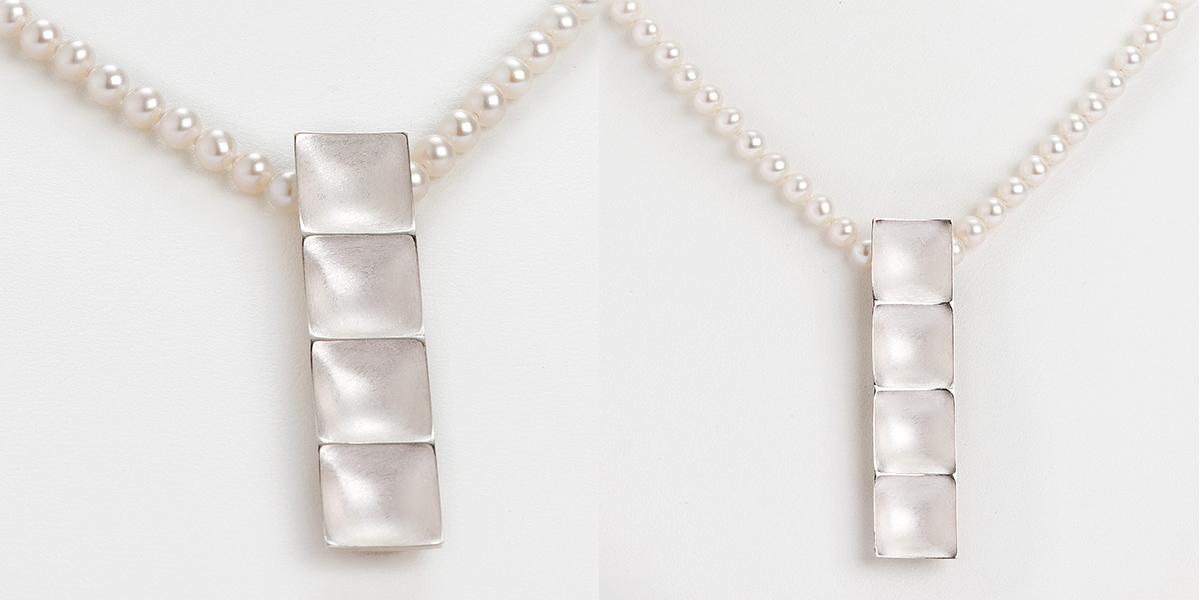 Hedendaagse sculpturale hanger in 18k wit goud met natuurlijke parels